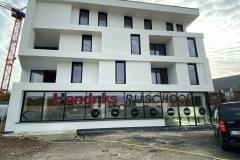 Nieuwbouwappartement met handelszaak